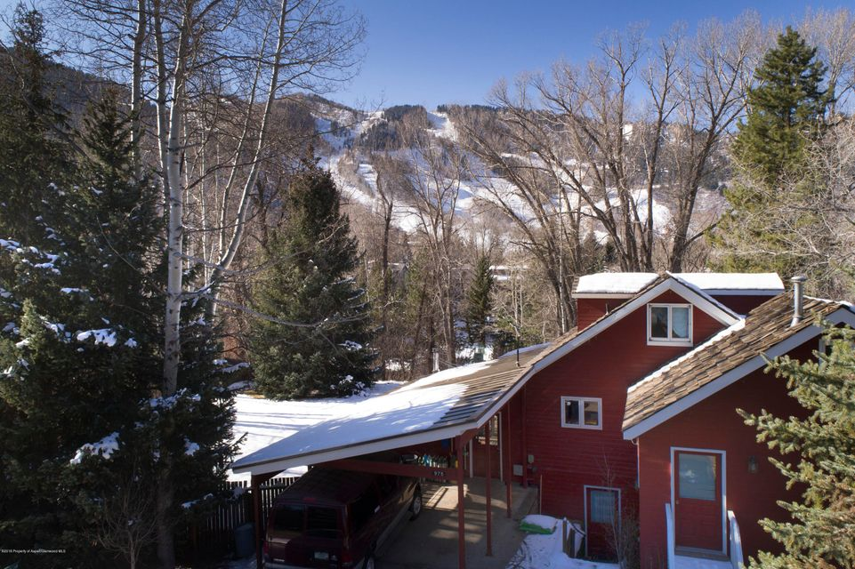 Prime Aspen property that captures the rare combination of views, privacy and a short walk to downtown shops and restaurants! Over a third of an acre with a flat building area and an existing home to rent or occupy during the design/permit/build process. Preliminary zoning analysis indicates a single family home or duplex of over 4,000 square feet above grade can be built (with additional below grade space). Herron Park and the Rio Grande trail are a three minute walk and the popular Smuggler & Hunter Creek trails are nearby. Great opportunity to build exactly what you want in a superb location.