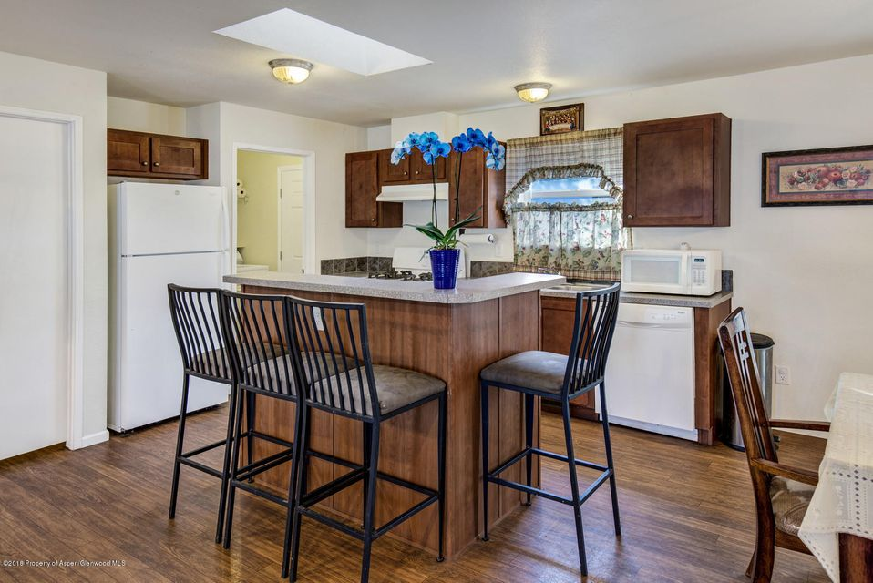 Well maintained 4 bedroom, 2 bath mobile home with  private yard and storage shed. Fantastic location near Whole Foods, City Market, Crown Mountain Park, Movie Theaters and great restaurants. Pets allowed, rentals allowed.