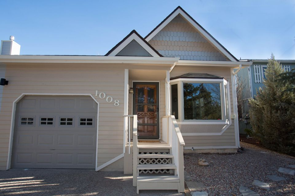 Fully remodeled, turnkey living in Carbondale.  Lovely 1,260 sq ft half duplex with fenced back yard & large deck. New kitchen appliances, cabinets & floor. New carpet in bedrooms. Huge sunny master with walk-in closet and private bath. One car garage with work bench & storage.  New roof in 2017. Attic & crawlspace air sealed and insulated. No HOA dues