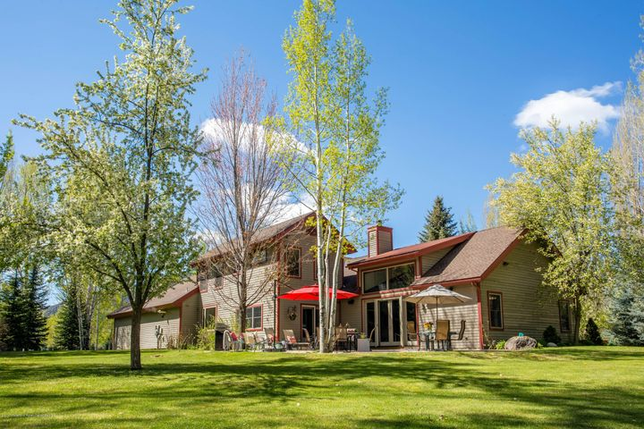Set on nearly two acres, this home enjoys a park-like setting.