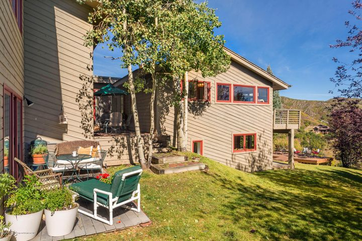 Property has a lovely yard and several patios and decks.