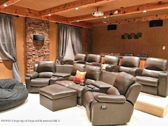 Grand home theater with stair stepped seating, beautifully finished