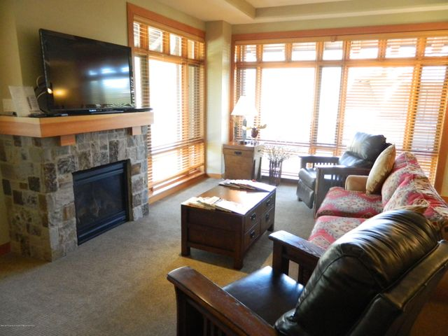 Open living room with leather recliners and pullout queen sleeper sofa