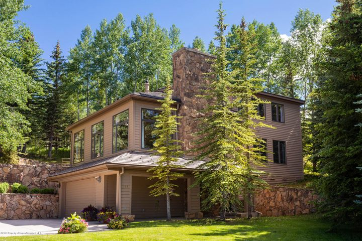 Nestled amongst stately evergreens, this home has a serene and peaceful ambiance.