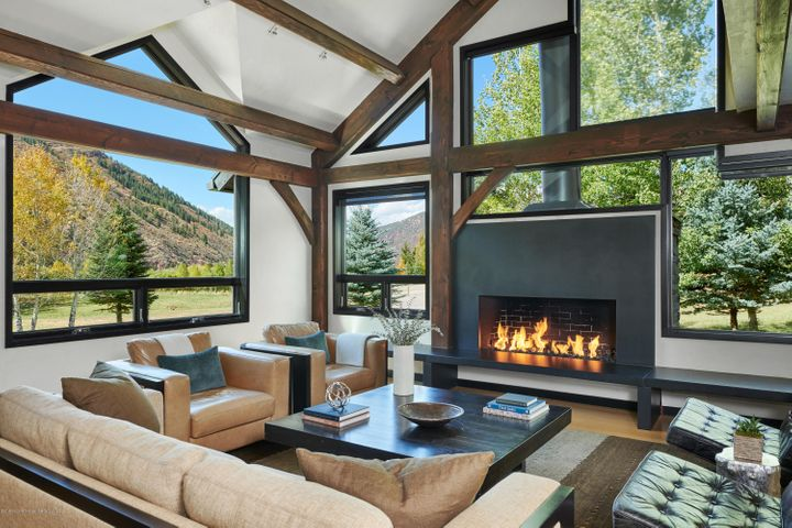 Great room with fireplace and views.