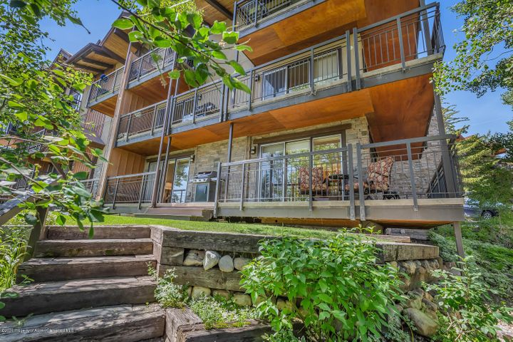 Conveniently located just steps to Snowmass Base Village, ski-in/ski-out, with a beautiful summer lawn.