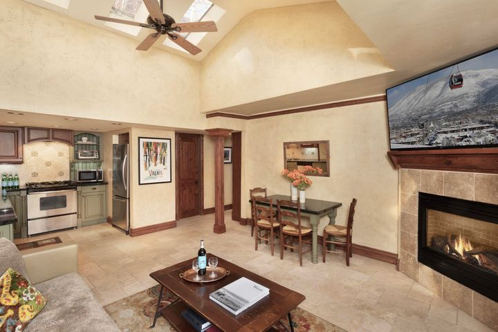 This property is sunny and warm thanks to vaulted ceilings and skylights. The living area features limestone floors and a gas fireplace.