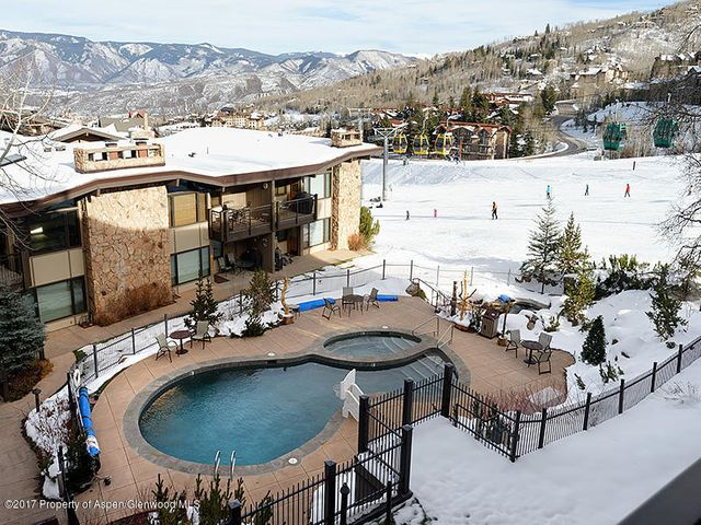 A very unique find!  This 5-bedroom condo is ski in/out on lower Fanny Hill. Two covered parking spaces! This single level condo boasts an oversized kitchen, large open plan living room and dining.   All 5-bedrooms have ensuite bathrooms.   The living room is wired for entertainment! Shadowbrook amenities include on site front desk services, including maintenance, housekeeping, swimming pool, hot tub and ski lockers.