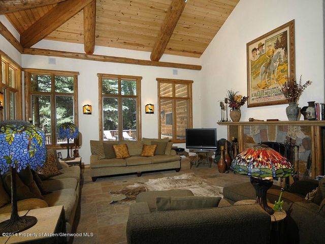 Priced at $275,900 less than Appraised Value! Imagine your Riverfront home with a great floor plan and guest home just 15 minutes from Aspen and a short walk to an Aspen favorite, the Woody Creek Tavern. The property features a spectacular private riverside setting, expansive level yard and pond all surrounded by lush mature pines, aspens and cottonwoods. The property is priced well below replacement value at only $685/sf, was built in 1995 to nearly current codes, and has radiant floor heat. There is only 1 home in sight from the home and no Hiway 82 noise. The estate is unique in that all square footage is entirely above grade, and features a majestic log detailed traditionaly constructed main home with an attached 2-car garage and a separate detached 1-car garage.