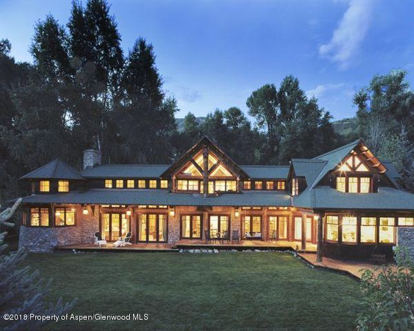 This magnificent Adirondack-style country lodge estate offers utmost privacy, serenity and abundant space for family and guests, yet it rests in the heart of Aspen just a 4-minute walk to Main Street and 8 minutes to the Aspen Mountain gondola. Cross the secret pedestrian bridge that ties this secluded oasis-like enclave to the action of Aspen and enjoy the best of both worlds. In addition to grand public rooms, the main residence hosts 4 bedrooms, luxurious baths, a state-of-the-art chef's kitchen, and much more. Across the park-like lawn, an 1880s vintage miner's cabin has been impeccably restored as a charming 2-bedroom guest cottage.