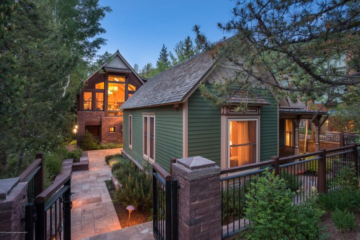 Downtown Aspen with views and on the river. An incredible and rare combination. A beautifully designed and finished six bedroom home that will capture your imagination. The quaint ''historic'' Victorian home that fronts the street opens up to an impressive addition designed by Poss Architecture. Nearly six thousand square feet of living space plus great decks and a patio overlooking the Roaring Fork River. An attached caretaker's apartment (or great guest quarters) with a separate entrance provides great flexibility. A two car garage, air conditioning and a quiet street with access to the Hopkins Avenue pedestrian/bike bridge across the Roaring Fork River are just a few of the additional qualities that make this home extraordinary!