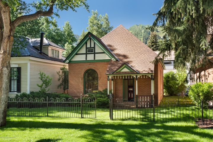 Very few of Aspen's historic homes are brick construction and this one is truly a gem. Prime location with easy walking convenience to downtown, an elegant curb appeal and great potential for future transformation into your Aspen dream. The 3,314 square foot lot should allow for nearly 2,500 square feet of FAR (below grade living space and garage receive generous exemptions), and there's the possibility of up to a 500 square foot bonus - development of the property is subject to City of Aspen Historic Preservation Commission review. Ask about seller's conceptual designs for a 3,850+ square foot house!