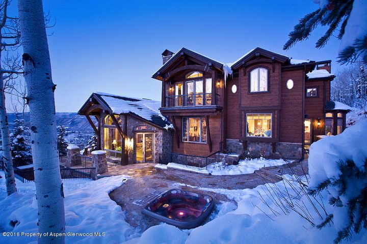 This expansive estate in Five Trees, near Aspen Highlands, offers over 9,800 SF of pure elegance.  All 6 bedrooms come with en suite bathrooms.  Additional features include:  two steam showers, a sauna, jacuzzi tubs, a luxurious theatre, multiple living areas, relaxing patios, and magnificent views from all angles!  This spectacular home must be seen in person to truly understand the workmanship and luxury it offers.