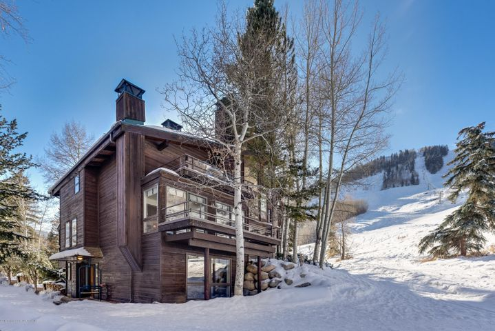 Capture the alpine lifestyle in this ground floor Mountain Queen 2 bedroom condo with mountain views and the convenience to hike, bike, ski or walk to all your favorite pastimes. The Interior features include an open floor plan with gourmet kitchen, dining area and living room with wood burning fireplace.  Additional features include ensuite beds and baths with a second wood burning fireplace in the master bedroom. The property is also enhanced with front and rear decks to enjoy indoor / outdoor living. The Mountain Queen complex provides all the amenities to make your alpine lifestyle a reality including a private tennis court, outdoor pool, his and hers locker rooms, hot tub and sauna area, assigned parking in the underground garage, elevator access, onsite management and concierge. The location is ideal as it lends itself to ski in / ski out access next to the Lift 1A at the base of Ajax and is steps from downtown to enjoy dining, shopping and the nightlife.