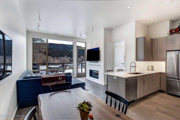 Beautiful, contemporary 2nd floor 1 bedroom condominium. Great light and views from your private patio with no road impact at all. Builder's warranty and the appliances still under warranty. 1 assigned parking spot in garage along with ample storage unit. Walk to Whole Foods and Rio Grande Trail.