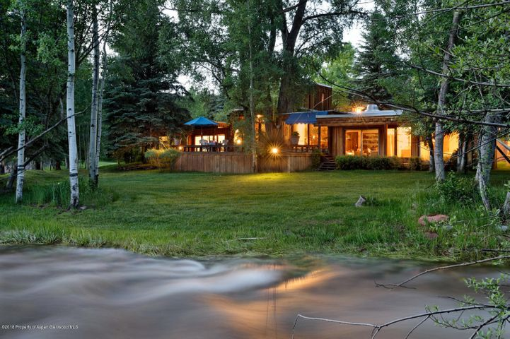 This legacy Ranch owned by the late Bob Beattie, founder of skiing's World Cup is a special piece of heaven. 5.89 acres fronting Woody Creek with a charming old Aspen home only feet from the creek. Featuring 3 bedrooms, 2.5 baths, and large decks. There is a 2 bedroom, 1 bath guest house, 2 car garage and carport, tennis court and other out buildings. Areas of groomed lawns and grazing pastures makes this special getaway one of a kind.