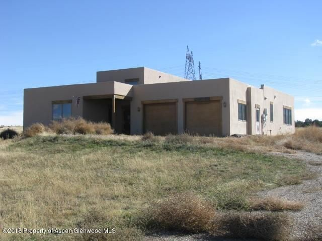 BEAUTIFUL VIEWS AND SUNSHINE ON 39.5 ACRES!  3BR, 3 BTH ranch style with 10 foot to 15 foot ceilings, lots of glass and an open floor plan. Propane radiant heat system plus a full solar system (27 panels) tied into the grid.  Large master bedroom and two additional larger bedrooms, each with walk-in closets and a bath.  Main living areas are tile with new carpet in all 3 bedrooms.  New range and dishwasher (no refrigerator)  2 gpm well plus 1200 gallon cistern to pump to and then out of.  Property is fenced and cross fenced, borders BLM, 12x36 horse shelter and small shed.Property subject to Freddie Mac First look Initiative thru 01/18/19, which means owner occupants only considered thru that date, no investors until after Jan 18th.