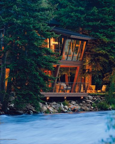 CALLING ALL FISHERMEN AND RIVER LOVERS! RiveRoar has never been offered for sale.  It sits directly on the banks of the Roaring Fork River where no new Pitkin County home can be built today. Current code requires a 100-foot setback.  Resembling a glass treehouse, the home appears to have been dropped by helicopter into a stand of more than twenty 75-foot evergreen trees and offers views from every room.  It has wonderful outdoor spaces to truly capture the river life during the day or at night by the fire-pit.  Watch suspended trout in the crystal-clear eddies from the cantilevered dining room window, cleverly designed by David Johnston's award-winning architectural team.