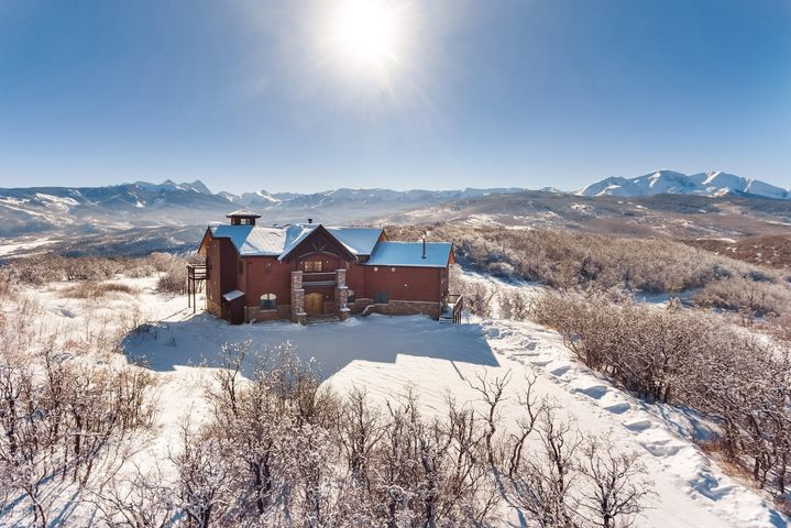 Earth and sky converge on this expansive mountain top manor. Perched at the end of the road on 38.4 acres and bordered by thousands of acres of wilderness, possibilities are endless at this private retreat. Located on a sunny mountain top, this home is all about living in the mountains.  Best 360-degree views of Sopris, Capital and all four Ski Areas in the valley. Large Alpine-meadow and horse area. Watch the sun rise and set, the clouds converge on Sopris, and the wildlife amble through the property. Ideal property for a hunter/outdoorsman, second home owner, horse enthusiast, or anyone looking to get away from it all! Large barn and ADU included with this energy efficient radiant solar heated home. Only 20 minutes from Basalt, Whole Foods & 35 minutes to to world class skiing.