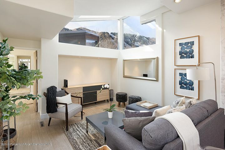 Don't wait to check this property out! Fantastic opportunity to own the largest unit in the coveted Villager Townhomes. This two-story corner unit features vaulted ceilings, abundant natural light, skylight views of Aspen Mountain and a wrap around balcony. Located five blocks from the Aspen Mountain Gondola and just two blocks from the supermarket you can walk everywhere! Remodeled in December of 2017 this home is turn-key.