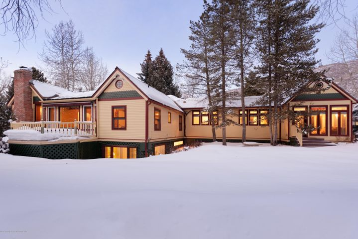 This non-historic home and separate ADU, remodeled in 2005, offers views towards Aspen Mountain, and is located one block from Herron Park and the Rio Grande Trail. Keep the 4-bedroom main house and 1-bedroom ADU above the 2-car garage or build new on this 15,478 sqft property located just 2 blocks from the center of Aspen. Based on the R-15 zone district, the allowable floor area for a single-family home is 4,248 sqft and 4,668 sqft for a duplex. The improvements are not designated historic. Please see document tab for survey, single family concept renderings and floor plans designed by Rowland & Broughton Architects.