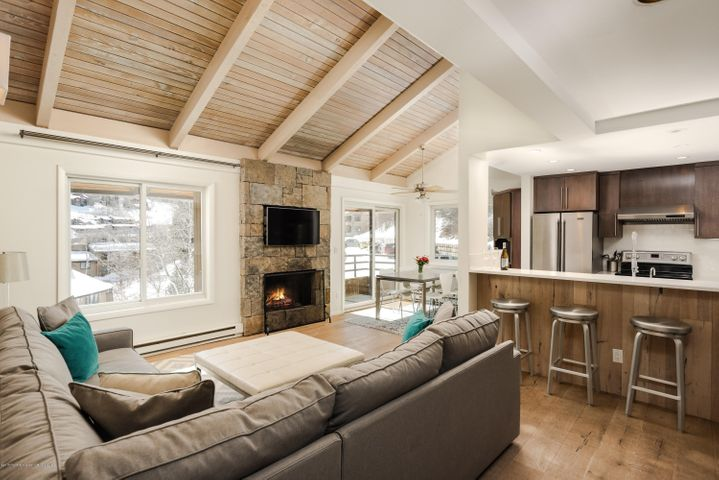 Snowmass Ski Area views and south facing sunshine abound from this top floor, corner three-bedroom condominium at Seasons Four in Snowmass Village. This is the best location at Seasons Four complex. Fully furnished with contemporary Room & Board furnishings and renovated in 2015 by Sweeney Construction with new kitchen, new baths, custom dry stack stone fireplace, and stackable in-unit laundry. The enclosed loft includes a bunk room, office, powder room, and abundant storage. End of the road privacy backed to open space with Snowmass Rim Trail above, no Brush Creek road noise, and parking steps from the front door make for easy living. Ski home or walk to summer concerts on Fanny Hill via the Melton Ranch Trail which runs behind the house. The pool, hot tub, sauna, HOA meeting room, bike storage and free town shuttle are nearby. Located within the Aspen School District. Pets are allowed for owners. Take in the views of Sam's Knob, Garret's Peak and Cirque Headwall from the great room. Low HOA's and strong rental history