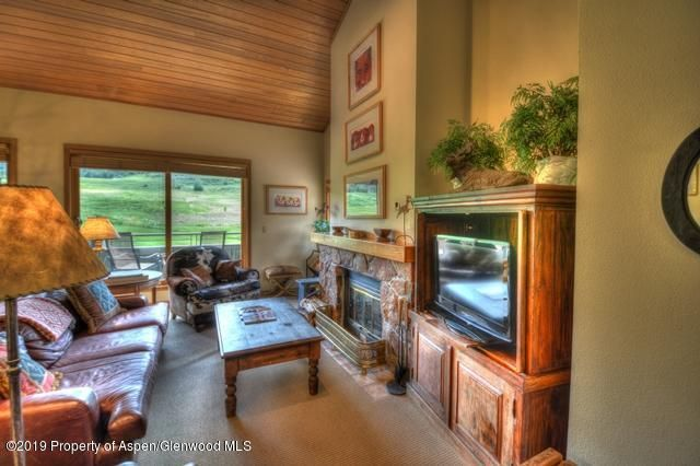 Top floor, vaulted ceilings and panoramic views of Snowmass Ski Mountain, Mt. Daly and the Snowmass Club golf course. 2 bedrooms/ 2 baths with updated furnishings for comfortable relaxation while on your mountain retreat. The purchase offers the opportunity to transfer the sellers Snowmass Club membership to the buyer by paying a transfer fee at closing and continuing paying monthly dues.  Village shuttle out your door, easy rental program through Destination Resorts and world class Club amenities offering tennis, pools, state of the art fitness facility and classes and championship golf course. A real estate package with something for everyone!