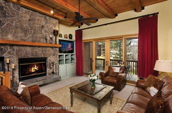 One of the largest townhouses at the Ridge. An additional space was added which created a fourth bedroom, bathroom and extra storage. The design features a spacious and open floor plan. You'll enjoy the high ceilings throughout and ensuite bedrooms. There are two generous sized outdoor decks with straight-on views of Mt Daly and the Snowmass Ski area. Additional features include an assigned carport, ski  access, a year-round heated pool and two outdoor hot-tubs.