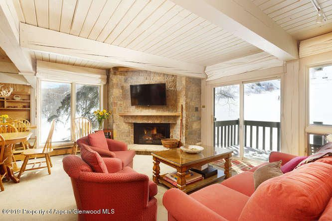 Spectacular views up Snowmass Mountain from this 2 bedroom/2 bathroom slopeside Interlude condominium. Watch the skiers go by from your living room feeling like you are part of the action! This condo has a unique additional window in the living room offering great views and extra sunlight. Assigned one car carport, locked owner storage for the condo are  rare amenities. Click in click out skiing, easy walk to the mall make this a very desirable complex. Recent additions of complex outdoor hot tub and snowmelt parking areas.