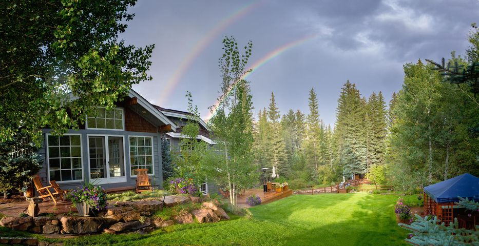 Welcome to ''The Retreat at Capital Creek''. Where beauty resides and adventure awaits.  Nestled in the trees, surrounded by over 1000 ft of private Capital Creek Frontage, this spectacular Jack Wilkie custom built home sits on 6 private acres in the stunning Rocky Mountains, just outside of Aspen.  Never again can you build so close to the water.  Fly fish, float or paddle board down the Creek, or just relax in sun on your private ''beach''.  Close proximity to hiking trails, horseback riding, skiing and biking.  This one of a kind legacy property has a 4815 sf main residence, a 850 sf guest cabin, and 920 sf of outbuildings.  Features include: an open floor plan, high ceilings, windowed walls, a spacious master suite, french doors leading to the expansive back patios and endless storage.  Enjoy breathtaking views from the living areas of Capital Creek, Mt. Sopris, open meadows and aspen groves. Centrally located 5 minutes to the Roaring Fork Club and 15 minutes to Aspen Airport.    This is a truly unique opportunity to own a remarkable property.