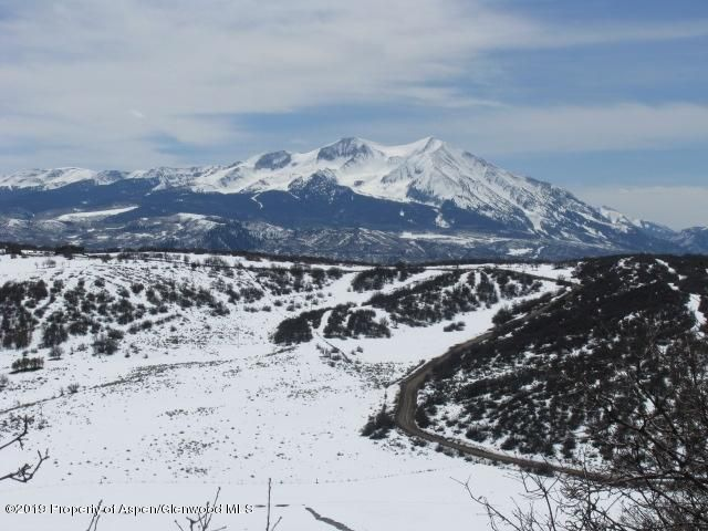 BEAUTIFUL VIEWS FROM THIS 7.6 ACRE BUILDING LOT ON MISSOURI HEIGHTS!  8.1 miles from Catherine Store at Hwy 82, a relaxing 15 minute drive through the Colorado Mountains on county maintained roads.Views from Aspen to Sunlight Ski Area and all day sunshine.  Property is sloping, but not steep in most places, borders a 700 acre ranch. Property has 1/3 interest in good producing well.  Utilities are at the lot line.  Buyer to install driveway to building site and install septic.  Seller may consider owner financing for qualified buyer.