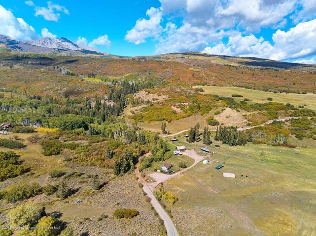 Rare and unique opportunity to own five buildable lots under one family compound!  Nothing exists like it this close to Aspen.   A true horse property with horseback riding outside your door, excessive water rights and meadows.   This 310 acre ranch boasts gorgeous views of the Elk Mountain Range, lush wildflower meadows and abundant water. Ultimate retreat feels a world away, but just an easy 25 minute drive to Aspen Snowmass Village.