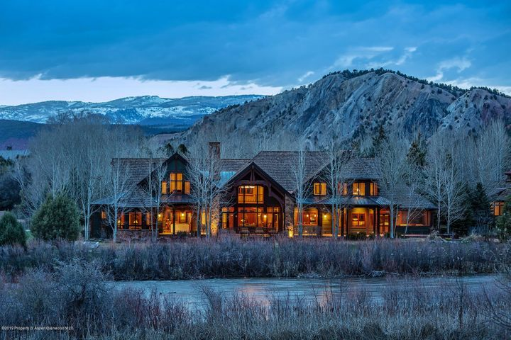 This home is a beautiful homage to the Craftsman timeless design. Exquisitely designed by John Muir & discerning owners with the accent on detail, and solidly built by BRIKOR. Located on the banks of the Roaring Fork River with sweeping views from Red Hill to Mt Sopris coupled with ''pocket water'' out the back door makes this home a fly fisherman's dream come true. The spacious kitchen beckons chefs and caterers with two of each high end appliances. A perfect family compound with 4 bedrooms, 6 baths, 3 offices/or additional bedrooms. Magnificent timbers grace the exterior & interior, cozy inglenook by the Great Room fireplace, Hubbardton Forge chandeliers fuse old & new centuries, Sapele Mahogany flooring, Central Vac, screened porch, outdoor spa & fire pit. Nothing is spared. Be a part of this vibrant, gated community where summer camp exists year round. Interesting, accomplished, fun neighbors who love to golf, hike, bike, ski, fish....come live the dream in Carbondale where a wonderful micro-climate supports golf from March to November and world class skiing is just up the road. Fly-fish/wade the 2 miles of Gold Medal Roaring Fork River that meanders through Aspen Glen.  A golf membership to the Jack Nicklaus/Jack Nicklaus II course is included. This is a must-see property! Discerning buyers, we invite you to experience this one-of-a-kind home in Aspen Glen.