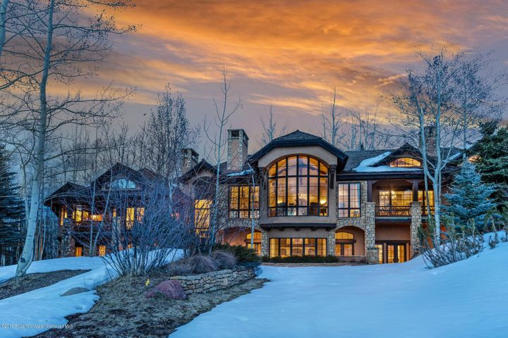 This gorgeous Aspen property is located in the ultra private and exclusive East Owl Creek neighborhood. Enjoy five beautiful acres complete with mature landscaping and your own private pond. This home enjoys a main-level master suite, outdoor hot tub, grand living room, chef's kitchen that opens to a large outdoor dining/entertaining space and a recreation room with pool table and wet bar. Each of the six bedrooms enjoys plenty of light and walks out to its own private patio.