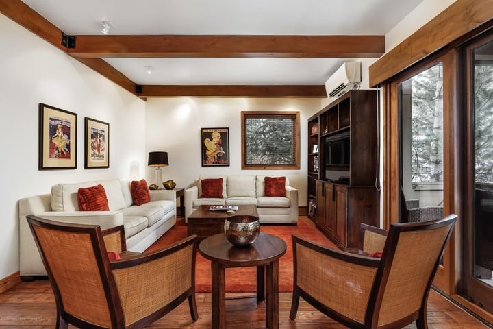 Located in the coveted and quiet ''G'' building, this two bedroom Premier condominium has it all.  Walk out to morning sun and enjoy the most private, serene, and well landscaped pool area in Aspen- a true oasis.  Stay warm next to the wood burning fireplace in the winter and enjoy the outdoor fire pit and grill area just outside all summer long.  An expanded floor plan and corner location means this condo lives BIG!  Beautifully finished and furnished with Mitchell Gold and Crate and Barrel.  Easy access to the Wheeler Ditch Trail, The ''Ute'' and all of the property amenities. Use as your Aspen retreat and let the excellent short term rental income pay for your vacations.  Access to world-class amenities including a front desk, concierge, bell staff, aspen transportation, gym, breakfast