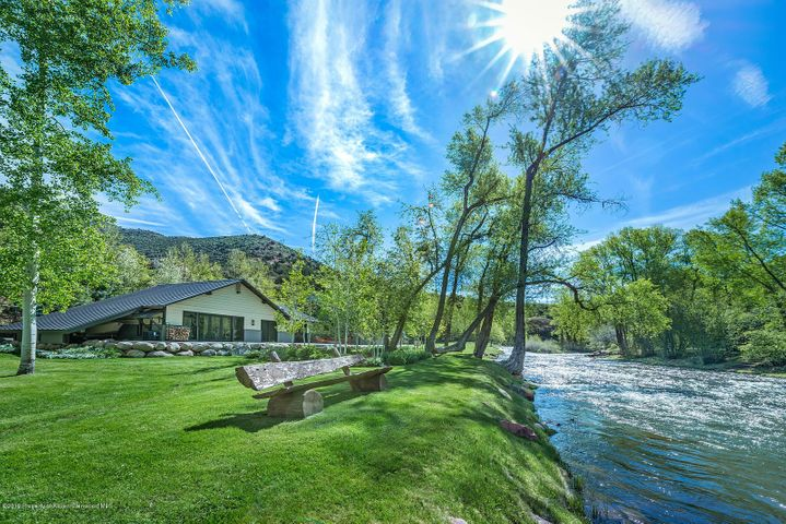 Nestled in a spectacular canyon-like setting flanked by inspiring cliff walls and lush timbered hillsides sits a private, riverfront fishery known as ''Starlight River Ranch''.  With fall-out-of- bed access to 582 feet of the ''Gold Medal'' Frying Pan River, this is a true fisherman's haven! Unforgettable in every way, this stunning home was built by Crawford Design Build of the Roaring Fork Valley.  The contemporary design features a blend of granite, marble, metal and reclaimed wood finishes all on one level, with most rooms opening to the outdoors and the river.  Custom touches such as ''live edge'' floors artfully weave together the natural elements. The main living area is ideal for entertaining with a gourmet kitchen, dining room for 10, and great room that seamlessly flow together while floor-to-ceiling glass accordion doors beckon the outside in.  The luxurious master suite is in its own private wing, and the master bath includes his and her vanities, separate water closet, and a double rain shower.  Thoughtful and forward-thinking in design, the home features skylights in all rooms with Haiku ceiling fans, a spectacular media/game room, Savant home automation system, Black Diamond TV screen and projector, 26-case wine cooling and storage system, office, gym, and an oversized 2 car garage with built-ins to store all your toys.  As a bonus, there is an additional covered space adjacent to the garage that is large enough to park a boat.         The property is landscaped to perfection with a tree-lined gated entry, vegetable and flower gardens, a pitch and putt golf green, and manicured lawns that stretch the entire length of the riverfront.  Invite the family and friends to gather around the gas fire pit to roast s'mores and gaze up at the stars as the river flows beside you. Water rights are included, and this is one of only a few flat-sited properties along the 42-mile long river.  Located just 7 miles from historic downtown Basalt, 16 miles from the Pitkin County airport, and 30 minutes from the world-class resort towns of Aspen and Snowmass Village, the ranch enjoys both the seclusion of a private retreat and opportune access to an array of restaurants, art galleries, cultural activities, shopping and medical facilities. This once-in-a-lifetime offering represents a prime opportunity to create a legacy!