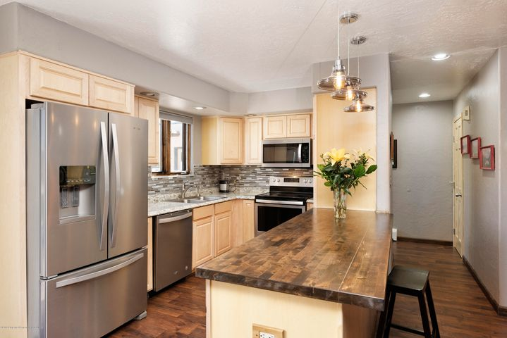 Extensively remodeled in 2018, this centrally located condominium in downtown Carbondale allows for simple living.  New kitchen cabinets, new counter tops, new appliances and washer/dryer, new floors, new doors and trim, new bathroom, new faucets, new paint, new electrical wiring and outlets, ceiling fans and lighting,  Secured 6 x 9 storage unit with shelving.  Possession to be July 1, 2019.