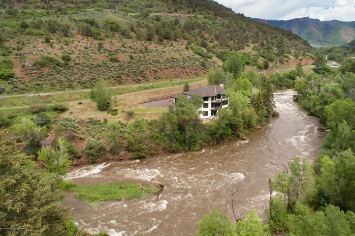 Spacious, private riverfront home located on the Roaring Fork River near the Old Snowmass intersection. Complete interior and exterior renovation with luxury mountain contemporary finishes and furnishings. Fly fishing enthusiasts will enjoy private riverfront access and space for a custom tack room. The main level features an open floor plan. The entire third level of the home occupies the luxurious master suite. On the lower level, entertain a large family or guests with 3 bedrooms and 2 bathrooms, a theatre room, entertainment room, and walk-out patio. Bicycle access to the Rio Grande Trail. Conveniently located just 5 minutes from the Roaring Fork Club, 8 minutes to downtown Basalt and 20 minutes to Aspen/Snowmass.