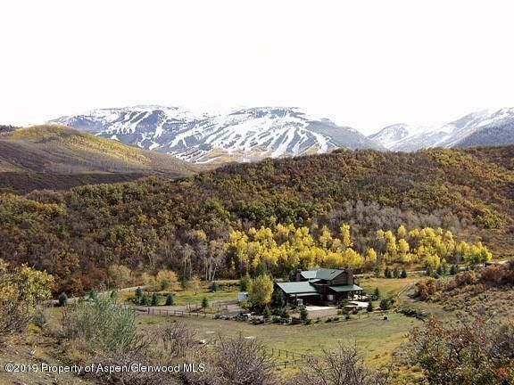 This idyllic ''Elk Mountain Ranch'' parcel is located in the heart of Old Snowmass, and offers 5245 square feet of memory making home style living. Easy 25 min access, to Aspen and Snowmass village. The house features an open floor plan, dramatic stone / cast iron staircase and many updated features. Enjoy this 4 bedroom, 3.5 baths Estate with nearly 40 acres to roam and ride. The parcel is ideally suited for horses with grazing land. Various horse trails and scenic vistas, and within a 20 min drive to White River National forest and Capital Creek wilderness areas. Land plan review approvals are in place for a 4000 sq. /ft. barn and 990 sq. /ft. of equipment storage, to enhance the already existing horse facilities. Many upgrades in this wonderful gentleman's ranch