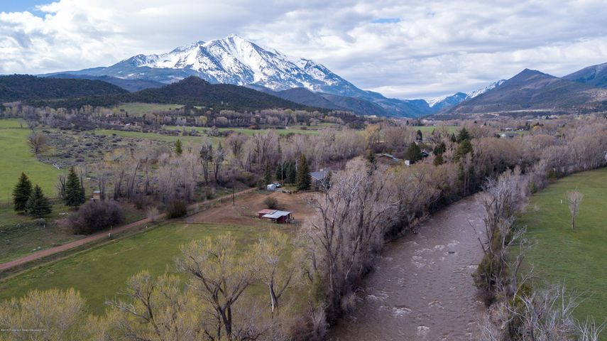 Rare opportunity to own an EXCEPTIONAL riverfront property located on the outskirts of Carbondale that has never been on the market before. This parcel, a little under 5 acres, parallels the Crystal River with expansive views of surrounding farmland and Mount Sopris. The property has junior water rights to the Ella Ditch and the potential for agricultural exemption. You can live in the current 2295 sq. ft. modest home or build your 15,000 sq. ft. dream estate with purchase of TDRs. Whether by car or a bike ride along the new paved bicycle path, you are a short 5 to 7 mins away from all of the conveniences of downtown Carbondale.