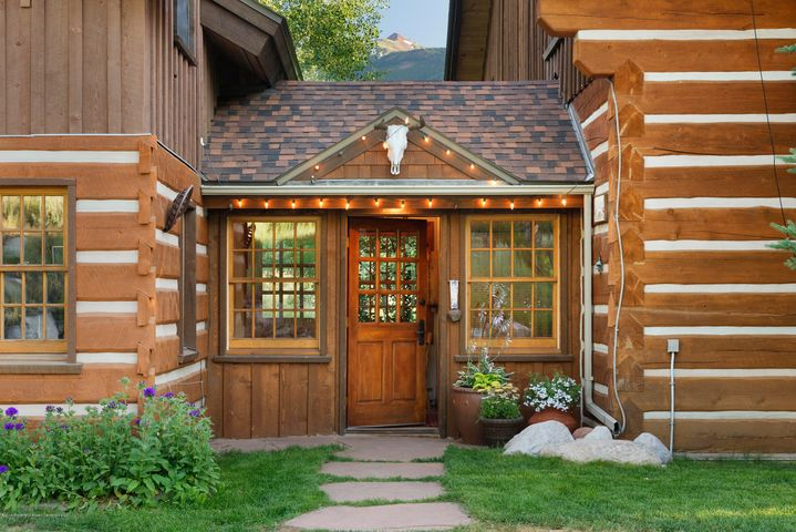 Enjoy fishing, hiking or horseback riding on this 35-acre wooded property straddling Snowmass Creek.  Extensive Snowmass Creek frontage and spring fed trout pond to enjoy or relax on the covered porch with views of Snowmass ski area and surrounding peaks. Light and open custom log home with vaulted ceiling, two story river rock fireplace and an abundance of windows makes this a one of a kind get-away. In addition, you will find a caretaker's cabin, barn/shop, and other outbuildings with endless possibilities for recreation, storage or family fun.