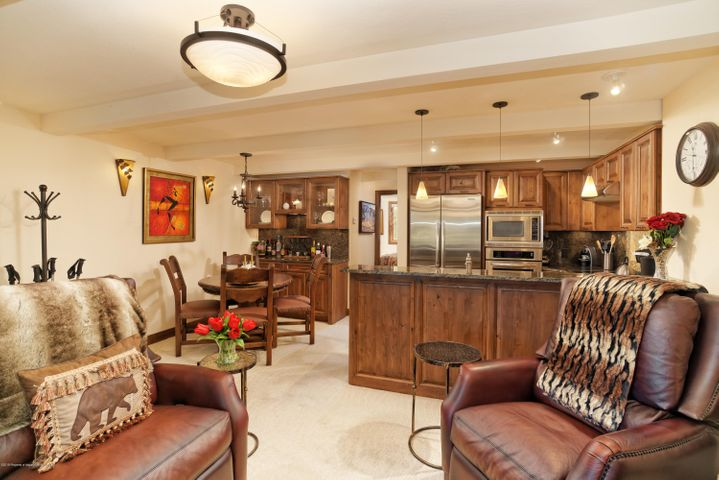 Enjoy in-town convenience walking distance to Aspen's best restaurants, galleries andshops at Midland Condo #6! Ski or snowboard down Little Nell and take a short stroll through Glory Hole Park to your backdoor. Watch ducks parade across the park from your private, second floor, west facing covered patio with BBQ, dinette and lock-off storage. A beautifully remodeled one-bedroom unit with solid slab granite countertops, stainless-steel appliances, travertine, and custom alder cabinets and built-ins. A wood burning fireplace warms the living room. A stackable washer/dryer is located in the bathroom. Sold fully furnished, move-in ready offering brand new living room furniture. Artwork is available for purchase separately. Off street reserved parking is available, but you'll never need to drive in this location. Enjoy views of Smuggler from your bedroom. Low HOA's and strong rental potential in an A+ location, two blocks to Gondola Plaza.