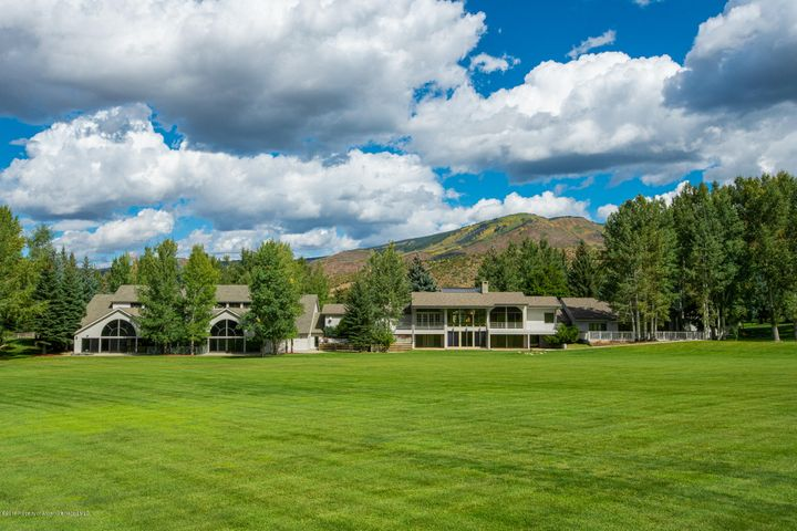 This is one of Aspen's legacy properties. The Merry Go Ranch is only minutes outside the core of Aspen and has over 21 acres with over 600 mature Evergreen, Aspen and Cottonwood trees. This property has rolling lawns and beautiful pastures the allow you to see the expansive panoramic views from all over the property. This ranch owns one of the largest water shares of the Salvation Ditch.  The main home with 5 car garage, caretaker home with 2 car garage and upper gym have uninterrupted views from Aspen to Snowmass Mountain. The Merry Go Ranch has the following improvements:  * 8,292 Sq. Ft. 8 bedroom Main Home with large outdoor decks and patios and 5 car garages. * 1.200 Sq. Ft. 2 bedroom Guest/ Caretaker  House with large decks and 2 car garage. * 13,000+ indoor gym with indoor tennis court, an NBA regulation basketball court, racquetball court,     exercise room with over 15 pieces of equipment, indoor pool, outdoor hot tub, media and game    room with pool table, massage room, kitchenette, equipment room, 2 bathrooms with steam    showers and laundry room. * Outdoor basketball court * 6,708 square feet of an eight-stall barn with drive in storage work area on the second level * Over 21 acres that are fenced and crossed fenced, currently has horses.  * 126 shares of the Salvation Ditch Rights that service an above ground irrigation system. * Award winning landscaping with over 600 mature trees and gardens. * They currently irrigate all 21 acres of the property. * There are shelters for horses and hay storage, as well as outdoor storage for horse trailers and more. * The lawns were set up for entertaining and have installed hard pack grass areas for delivery trucks and set of of tents.  Per Pitkin County Assessor: Main House, indoor pool gym, garage: 21,292 sq. ft. Barn: 6,708 sq. ft. Guest House: 1,200 sq. ft. Total Area : 29,200 sq. ft.