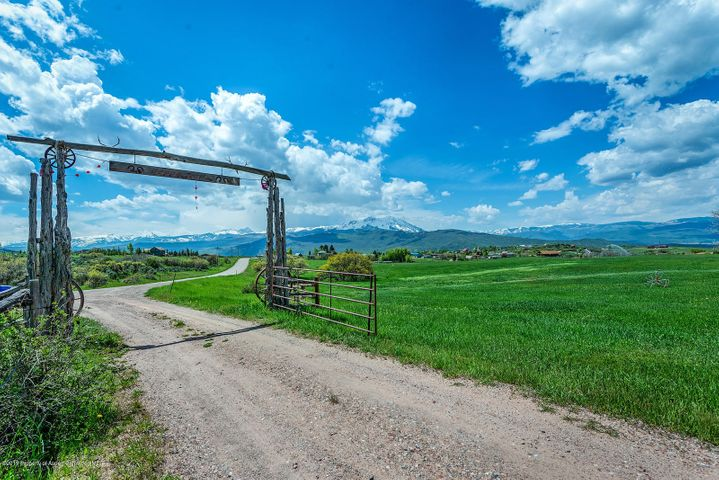 One of a kind. Conserved 80 acre ranch with over 500 shares of water rights. Breathtaking views of Elk Mt Range. Privacy. Ability to ranch. Live in the existing house while you build your custom home (Building envelope is 3 acres and 3.5 acre agricultural building envelope). Original house can be downsized and used for caretaker, family visits or income.