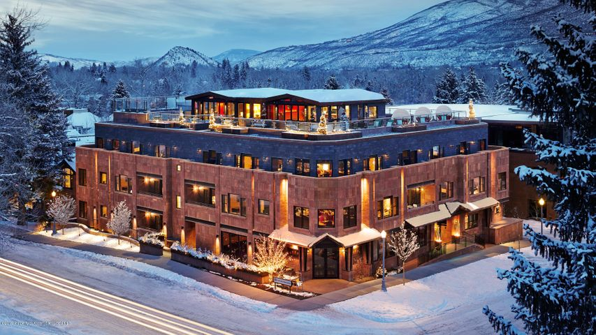 Aspen's premier downtown Dancing Bear Residences. The Dancing Bear offers unparalleled amenities and service, such as a private wine cellar and dining room, a private theater, a chic rooftop lounge, a fitness area, and a relaxing spa. This is a top-notch experience that will become your home away from home. The downtown location offers accessibility to everything Aspen has to offer. Kick back and relax after a day of hiking or skiing in this exclusive property.