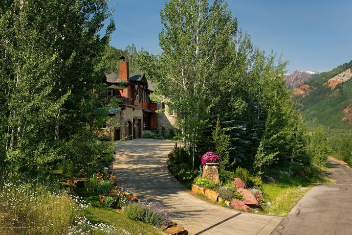 This spacious, elegant, immaculately maintained, 9810 sq.ft. estate, situated on almost an acre site, is well located in a quiet, ski accessible neighborhood, just minutes from Aspen Highlands, Aspen schools and downtown Aspen.  The home boasts top quality finishes, abundant amenities, ample natural light, enviable outdoor entertaining spaces, mature landscaping and trees and stunning mountain views. Featuring 5 luxurious bedroom suites plus a gym which could be a 6th bedroom, 2 offices, 8 gas fireplaces, 3 laundry areas, 2 steam showers, a large steam room, a sauna, indoor jetted tubs, an 8-person movie theater with massage recliners, a custom, temperature controlled wine room and tasting area, 2 bar areas, multiple living areas, 3 car garage plus a separate bay for trash receptacles. Enjoy privacy and relax on the decks and stone patios complete with water features, waterfalls, streams, built-in fireplace, built-in grills and a large outdoor hot tub. The backyard is completely fenced for your four-legged furry family members. The home is ideal for entertaining large groups - winter or summer. Summer time brings beautifully landscaped gardens and the kitchen has clever pass through windows to the dueling, built-in Bar B Ques on the stone patio. Master suite has 2-sided gas fire place, wet bar ideal for morning coffee or a glass of champagne, his/hers walk in closets with washer/dryer for convenience, his and hers water closets, the waterfalls can be heard from the large balcony overlooking the garden and hot tub below. Driveway and portions of the patios and decks are snowmelted. The Five Trees neighborhood has its own chair lift (shared with the high school) which runs to the midpoint of the Thunderbowl ski trail at Aspen Highlands. The Five Trees Homeowners Association provides complimentary on demand taxi service to and from downtown Aspen and the Aspen Airport.  Exclusions include artwork, rugs, sellers personal property.