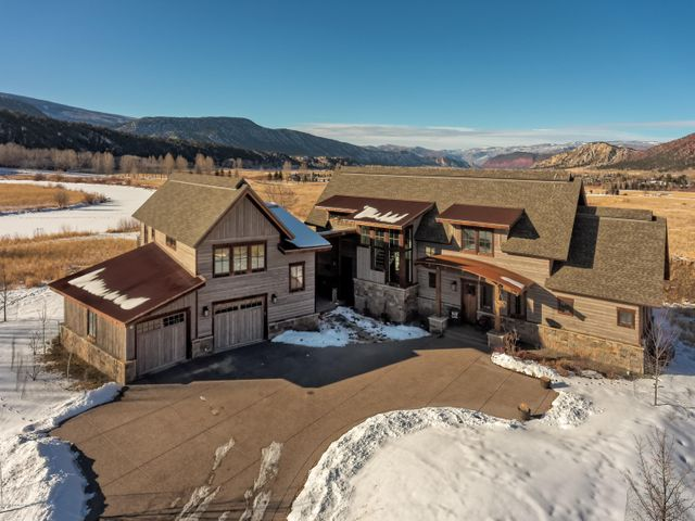 GORGEOUS new construction in Midland Point overlooking the pond and surrounded by open space! This is easily one of the most desirable and stunning homes on the market. The house was meticulously designed to take advantage of the views and features an inviting gourmet kitchen, a dining room surrounded in glass that opens onto the wraparound deck for indoor/outdoor entertaining plus a main floor bedroom with a luxurious marble bathroom.  The glass enclosed staircase is a beautiful feature that leads upstairs to the Master Suite plus 2 additional bedrooms. If more space is needed, there is an unfinished lower level designed for two additional bedrooms, a family room and media room.  Across the breezeway is a 3 car garage plus workshop/flex space above the garage. This is truly a slice of paradise with the magical sunsets, privacy and open space.  The kids can enjoy fishing and canoeing on the pond in the summer and ice skating and hockey in the winter.  Not to mention that Midland Point Subdivision has access to the Crystal River too!  It's the best of both worlds with a rural feel but just a bike ride to downtown Carbondale. This is a must see... it checks all the boxes on every buyer's wish list!
