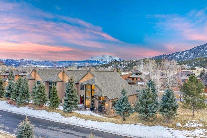This beautifully remodeled Peaks Townhome boasts vaulted ceilings, plenty of natural light, 4 bedrooms, 3.5 bathrooms, and a finished basement complete with a wet bar and wine cooler. The main floor master includes a gas fireplace, jetted tub, and a private patio entrance. Experience all that Aspen Glen has to offer from private fly fishing access, world-class golf, tennis, dining, and more! Enjoy a low-maintenance lifestyle at the Peaks at Aspen Glen, a private Club Corp country club. Visit www.aspenglenliving.com for more information.