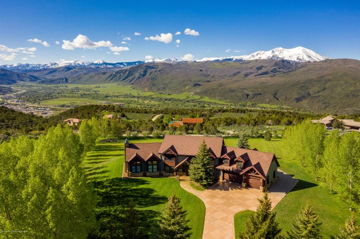 Located on a premier lot in Fox Run Meadows sits this beautiful custom-built estate property. The south-facing home was designed to capture the amazing views of the Elk Mountain Range from Aspen to Sunlight with Mt. Sopris front and center. The 2+ acre property is made private by mature trees lining the lot boundaries. The floorplan features a two-story great room surrounded by windows under cathedral ceilings and anchored by a floor-to-ceiling wood-burning fireplace. You can also walk out to the covered patio and back yard from here. The master suite is fit for a king and queen with pillow views of snow-capped peaks, a well-appointed ensuite bath and a huge walk-in master closet. And there's plenty of room for your cars and toys in the oversized garage with bonus room above.