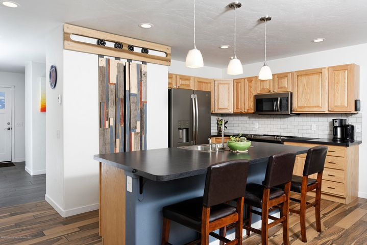 Walk to downtown Carbondale from this beautiful home!!  LOTS of upgrades including a 3.3 kilowatt array (near net zero with current usage), tile and bamboo flooring, new stainless appliances, covered front porch.  The 4th bedroom is ''non-conforming''- great use for a bedroom OR a home office. Southern exposure allows for incredible natural light.  Green space for all to play. Views of Mt Sopris.